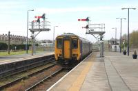 Northern 156479, on a service from Carlisle and Workington, runs past the carriage sidings and signal box and in to Platform 2 at Barrow-in-Furness. The train will continue via Ulverston to eventually terminate in Lancaster.<br><br>[Mark Bartlett&nbsp;28/04/2014]