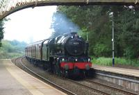 Royal Scot 46115 <I>Scots Guardsman</I> brings the <I>Great Britain VII</I> tour north through Dalston, Cumbria, on Day 4 of the round Britain trip. The special is heading for Carlisle, then on to Edinburgh. <br><br>[John McIntyre&nbsp;29/04/2014]