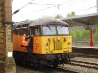 Colas Rail 56094 seen during a quick driver change at Crewe station whilst returning from Rolls-Royce at Sinfin, Derby, to the Ineos refinery at Grangemouth, with empty aviation fuel bogie tanks. <br><br>[David Pesterfield&nbsp;01/05/2014]