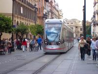 <I>Look - no wires!</I> Tram 304 running in battery mode along interlaced tracks in Archivo de Indias on a non-catenary section of Seville's 2.2 km city route T1 in May 2013.  The Urbos 3 vehicles, built by CAF, feature an Energy Accumulation System enabling them to operate wirelessly over certain sections of the network. [See image 47207]<br><br>[Andrew Wilson&nbsp;01/05/2013]