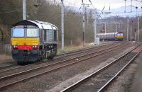 DRS 66428 has the <I>feather</I> for Coatbridge container terminal having run light from Mossend. In the background DBS 66132 approaches with empty coal hoppers from Longannet to Hunterston. [Ref query 7619]<br><br>[Bill Roberton&nbsp;17/04/2013]