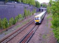 A down Clubman leaves High Wycombe station on the former four-track GC and GW joint section on 26 April 2014. That creeper on the cutting wall, which contains 1.2 million bricks - give or take a dozen - looks rather tenacious. [compare to image 49508]<br><br>[Ken Strachan&nbsp;26/04/2014]