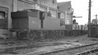 Drummond M7 0-4-4T no 30676 stands in the shed yard at Exmouth Junction on a wet 10 August 1960, approximately one year before withdrawal.<br><br>[K A Gray&nbsp;20/08/1960]