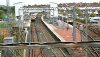 Looking east over Airdrie station on 8 May 2014. The 09.57 Milngavie - Edinburgh Waverley has just arrived at platform 3, while the 10.56 service to Balloch is awaiting its departure time in bay platform 1. [See image 50194]<br><br>[John Furnevel&nbsp;08/05/2014]
