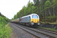 DBS 67026 <I>Diamond Jubilee</I> approaches Carrbridge on 10 May with a railtour for Inverness.<br><br>[John Gray 10/05/2014]