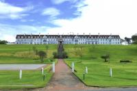 Designed by James Miller, built by the Glasgow and South Western Railway Company and opened in 1906 as the Station Hotel, Turnberry. View from the west in May 2014 [see image 7207]. <br><br>[Colin Miller&nbsp;11/05/2014]