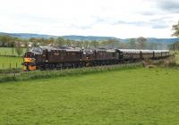 37685 <i> Loch Arkaig </i> and 37516 <i> Loch Laidon </i> bring  <i> The Royal Scotsman </i>  round the curve at the west side of  Beauly on 8 May on the way to Kyle of Lochalsh.<br><br>[John Gray&nbsp;08/05/2014]