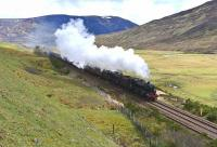 Black Fives 44871 and 45407 double head <I>The Cathedrals Explorer</I> northbound through Druimuachdair Pass on 10 May 2014.<br><br>[John Gray&nbsp;10/05/2014]