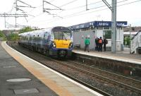A crew change about to take place on the 09.48 Edinburgh - Helensburgh service during its stop at Airdrie on 8 May 2014. <br><br>[John Furnevel&nbsp;08/05/2014]