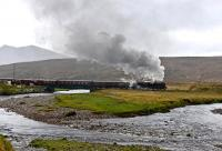 <I>The Highlands and Islands Explorer</I> photographed west of Achnasheen on Sunday 11 May, with the rain continuing to sheet down. Black Five No.45407 is leaving for Kyle of Lochalsh after a water stop.<br><br>[John Gray&nbsp;11/05/2014]