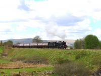 Black Five No.44871 racing along west of Rogart on 12 May with <I>The Cathedrals Explorer</I> on the way to Dunrobin Castle.<br><br>[John Gray&nbsp;12/05/2014]
