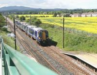 The 12.11 Edinburgh Waverley - Dunbar is about to run through Wallyford station on a warm and sunny 13 May. This service calls only at Musselburgh during its 25 minute end-to-end journey.  <br><br>[John Furnevel&nbsp;13/05/2014]