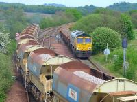 DBS 66188 passes Freightliner 66622 at Inverkeithing East Junction on 18 May with ballasts to/from Millerhill and Stirling via Cowdenbeath and Alloa.<br><br>[Bill Roberton&nbsp;18/05/2014]