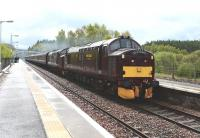 37685 <i>Loch Arkaig</i> and  37516 <I>Loch Laidon</i> pass through Carrbridge in the rain on 10 May with an SRPS Railtour from North Berwick to Kyle of Lochalsh.<br><br>[John Gray 10/05/2014]