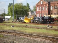 A quartet of propelled snow ploughs in the down side stabling sidings at Doncaster on 21 May 2014. On the far left an East Coast DVT is on the works head-shunt attached to a class 08 shunter.<br><br>[David Pesterfield&nbsp;21/05/2014]