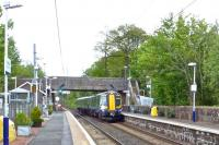 The 14.30 Glasgow Central - Ayr dashes through Lochwinnoch at high speed on 14 May. This train's first stop will be at Kilwinning and the end to end journey time is a scheduled 48 minutes.<br><br>[Colin Miller&nbsp;14/05/2014]