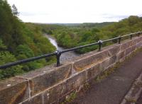 Looking North up the South Tyne from the former Alston branch viaduct, which closed to all traffic in 1976; but was restored and reopened as a footpath in 1996. Cycle access is possible, but not recommended as a through route; as the footpath diverts down steps at the South end of the viaduct.<br><br>[Ken Strachan&nbsp;22/05/2014]