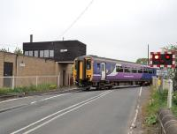 156475 moving out of the turnback sidings on the Blyth line and crossing Coopies Lane at Morpeth on 21 May. Morpeth station is just off picture to the left.<br><br>[Peter Todd&nbsp;21/05/2014]