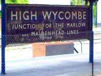 Amazing what you find when you take down a few old posters. Seriously outdated station sign at High Wycombe in April 2014. The connections to Marlow and Maidenhead were severed some 44 years ago.<br><br>[Ken Strachan&nbsp;26/04/2014]