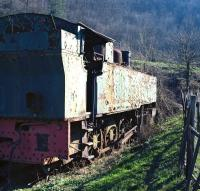 When viewed from the rear, the massive bulk of French built 0-8-0T No. 144R03, seen here dumped at Oskova, Bosnia on 14th March 2014, seems more reminiscent of some Edwardian era British tanks - for example the LSWR 4-8-0Ts of class G16 - and it comes as something of a surprise to find it was built as late as 1954.<br><br>[Bill Jamieson&nbsp;14/03/2014]