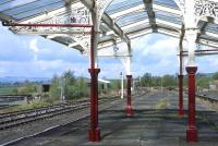 The recently restored canopy at Hellifield makes a very attractive frame for the various signals on the down side. This end of the island platform has not been raised as part of the refurbishment works and is no longer used, although it can still be accessed when the tearoom is open.<br><br>[Bill Jamieson&nbsp;14/04/2014]