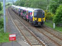 First TransPennine 350410 passing Curriehill on 27 May with a Manchester Airport - Edinburgh train.<br><br>[Bill Roberton&nbsp;27/05/2014]