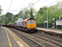 66709 northbound off the curve and through Morpeth station with a ballast train on 23 May 2014.<br><br>[Peter Todd&nbsp;23/05/2014]