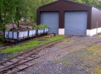 Any electrical engineers out there will recognize this as the 'earth line'. Civil engineers wagons outside the carriage shed at Alston on 22 May 2014.<br><br>[Ken Strachan&nbsp;22/05/2014]