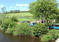 Looking across the River Till, Northumberland, on 20 May as a train departs from Heatherslaw Mill bound for Etal Castle on the Heatherslaw Light Railway, hauled by Alan Keef 2-6-0T <I>Bunty</I>.<br><br>[Peter Todd&nbsp;20/05/2014]
