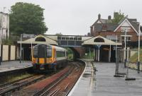 A Waterloo to Weymouth service, formed by SWT 444005, calls at Branksome, between Bournemouth and Poole, on a very wet morning in May 2014. <br><br>[Mark Bartlett&nbsp;23/05/2014]