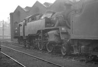 Standing alongside the shed at Dalry Road on 28 March 1964 is BR Standard tank no 80022. In the background is Fairburn 42273, a regular on station pilot duties at nearby Princes Street [see image 33025].<br><br>[K A Gray&nbsp;28/03/1964]