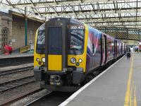 TransPennine 350403 pauses at Carlisle on 29 May with the 10.08 Edinburgh - Manchester Airport service.<br><br>[Bill Roberton&nbsp;29/05/2014]