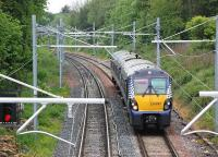 334035 approaches Cumbernauld from the Glasgow direction on 30 May 2014.<br><br>[Bill Roberton&nbsp;30/05/2014]