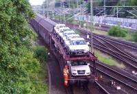 Freight in Lubeck goods yard on 1 June 2014, including a consignment of new Audis.<br><br>[John Steven&nbsp;01/06/2014]