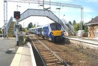 334029 runs over the level crossing as it arrives at Cardross with an eastbound service on 31 May 2014.<br><br>[John McIntyre&nbsp;31/05/2014]