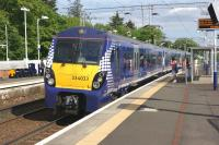 Almost at the end of its journey, ScotRail 334033 on an Edinburgh Waverley to Helensburgh Central service calls at Cardross on 31 May 2014.<br><br>[John McIntyre&nbsp;31/05/2014]