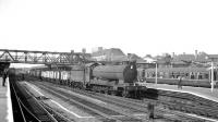 O4 2-8-0 no 63818 brings mineral wagons south through Doncaster on 20 July 1963.<br><br>[K A Gray&nbsp;20/07/1963]