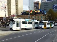 A Z Class and an A Class tram pass at the junction of St. Kilda Road / Swanston Street and Flinders Street, Melbourne on 11 May 2013. Just off to left is Flinders Street Station.<br><br>[Colin Miller&nbsp;11/05/2013]