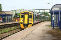 Northern 158754 passes through Rishton non-stop on a York to Blackpool service on 6 June 2014.<br><br>[John McIntyre&nbsp;06/06/2014]