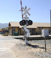 Railroad Crossing at Tehachapi Depot, California on the Union Pacific line connecting Bakersfield and Mojave in April 2014. The station closed in the 1960s. The depot building (rebuilt) beyond the crossing houses an excellent railway museum.<br><br>[Brian Taylor&nbsp;15/04/2014]