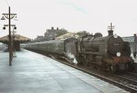 Maunsell U class 2-6-0 no 31639 calls at Basingstoke in August 1964 with a local train. <br><br>[John Robin 24/08/1964]