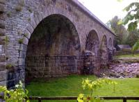 This picturesque viaduct, photographed on 22 May 2014, is situated north of Slaggyford on what is now the South Tynedale Railway. There is some rather nice skew stonework under those arches.<br><br>[Ken Strachan&nbsp;22/05/2014]