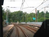 Closed Woodlands Road station, as seen from a passing Bury bound Metrolink tram in June 2014. Opened in 1913 it was due to close when nearby Abraham Moss opened in 2011 but objections meant this was delayed until December 2013. This image shows the platforms cut back and the buildings removed and work continued until most traces of the station were cleared altogether [See image 51158].<br><br>[Mark Bartlett&nbsp;09/06/2014]