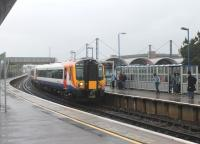 Passengers waiting in very heavy rain at Poole on 23rd May 2014 were glad of the large platform shelters. SWT 444037 pulls in on a stopping service for Waterloo ex-Weymouth. The arched roof sections of the modern station building can be seen to the right of the train.<br><br>[Mark Bartlett&nbsp;23/05/2014]