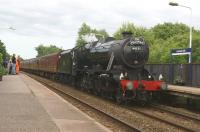 11 June 2014 was the first Wednesday of the 2014 season for the weekly <I>Fellsman</I> railtour from Lancaster to Carlisle via the S&C. Doing the honours on the first outing was Stanier 8F 2-8-0 no. 48151, seen here on the return trip passing through Lostock Hall station.<br><br>[John McIntyre&nbsp;11/06/2014]