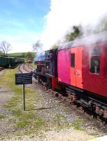 Not every day you see the original SDLUR '<I>plum, mandarin, and raspberry</I>' coach livery. Peckett no. 2084 [see image 44743] makes an enthusiastic departure from the recently lengthened platforms at Kirkby Stephens 'other' station.<br><br>[Ken Strachan&nbsp;17/05/2014]