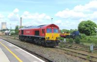 66118 dead in the sidings alongside Didcot station on 12 June 2014, now in DB Schenker colours.<br><br>[Peter Todd 12/06/2014]
