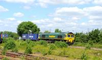 Freightliner 66502 with an eastbound container train at Didcot on 12 June 2014. Unfortunately the locomotive went on to suffer a brake fire at Tilehurst, resulting in closure of the GW main line for approximately two hours.<br><br>[Peter Todd 12/06/2014]