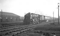 Royal Scot 46128 <I>The Lovat Scouts</I> approaching Carlisle from the south past a busy looking Crown Street goods depot on an overcast 22 December 1962. The train is the  9.35am Liverpool Exchange - Glasgow Central.<br><br>[K A Gray&nbsp;22/12/1962]