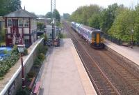 The 11.46 to Carlisle arrives at a well-kept Settle station on 20th May.<br><br>[Ken Strachan&nbsp;20/05/2014]